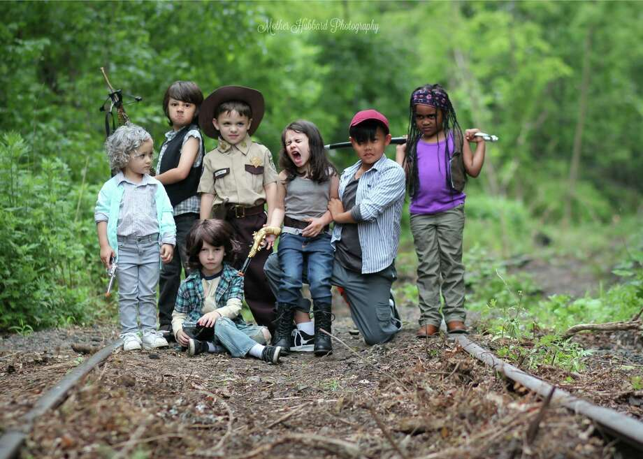 "A New Jersey photographer is dealing with both praise and backlash for the following photos, which show young children acting out scenes from the mature-rated TV show, ""The Walking Dead."" Photo: Alana Hubbard/Mother Hubbard Photography"