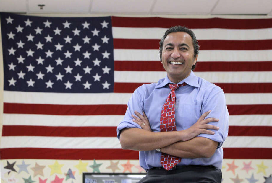 FILE -- In this Oct. 26, 2012 file photo, Rep. Ami Bera, poses for a photo at his campaign office in Elk Grove, Calif. Bera in 2012 defeated incumbent Republican Dan Lungren in the race for California's 7th Congressional district. With his election to Congress, Bera joined a growing number of Californians of Indian descent, to emerge in politics despite their relatively small population.(AP Photo/Rich Pedroncelli, file)