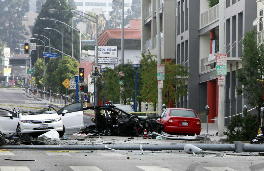 In this photo taken July 4, 2014, a Hollywood street is closed at an accident scene during an investigation after a car crash in West Hollywood, Calif. The chances of dying in a crash in a late-model car or light truck fell by more than a third over three years, and nine car models had zero deaths per million registered vehicles, according to a study by the Insurance Institute for Highway Safety (AP Photo/Richard Vogel)