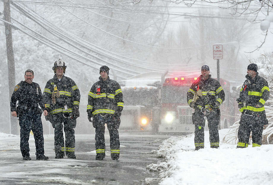 Hour photo / Erik Trautmann Emergency personel respond to the scene where electrical wires fell onto a Norwalk Transit District Wheels bus on Fairfield Ave. The road remained closed following the incident.