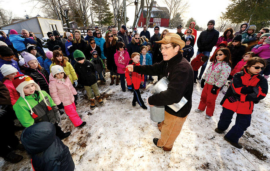 Hour photo / Erik Trautmann Ambler Farm program director Kevin Meehan welcomes local residents to the annual Ambler Farm Maple Syrup Program Saturday.