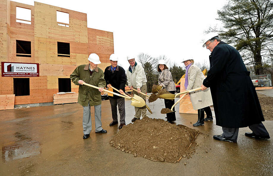 Resident George Ciaccio, architect Louis Contadino, Wilton Commons board member Buck Griswold, CEO of Mutual Housing of Southwestern Connecticut Renee Dobos, Wilton First Selectman Lynne Vanderslice and chairman and president of Wilton Commons, Inc., Phil Lauria, take part in the ceremonial ground-breaking for the new building at Wilton Commons on Wednesday.