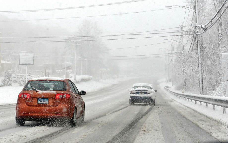 Hour photo / Erik Trautmann White out conditions on Main Ave in Norwalk Friday.