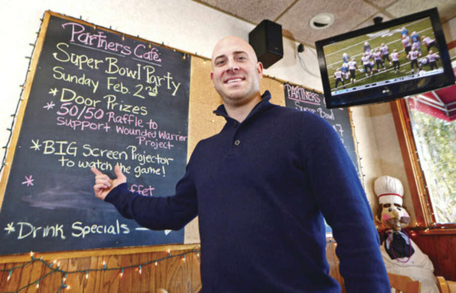 Hour photo / Erik Trautmann Partner's owner, Ernie Marsan, is getting ready for the big game which can mean big business for local bars and restaurants.