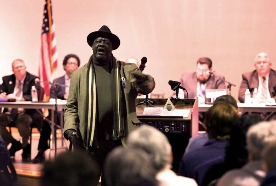 Louis Wilson, a Ferguson, Mo., resident for 16 years, turns to talk to the crowd Tuesday, Feb. 9, 2016, as he addresses the Ferguson city council during the public comment portion of a meeting where a consent decree with the United States Department of Justice was discussed. Ferguson passed a modified version of the consent decree. It is unclear if the Department of Justice will accept the modified version of the consent decree Ferguson passed. (David Carson/St. Louis Post-Dispatch via AP)