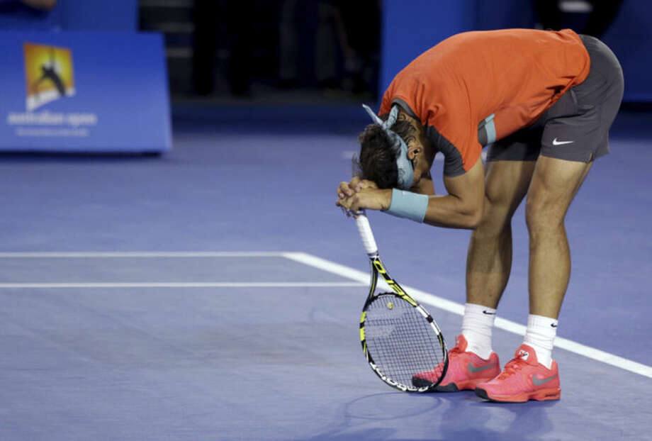 Rafael Nadal of Spain reacts as he plays Stanislas Wawrinka of Switzerland during the men's singles final at the Australian Open tennis championship in Melbourne, Australia, Sunday, Jan. 26, 2014. (AP Photo/Aaron Favila)