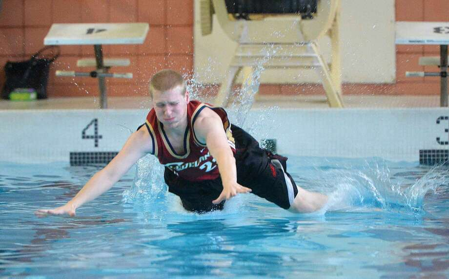 Hour Photo/Alex von Kleydorff Mike Stein hits the water during a Belly flop fundraiser with the Bears Beating Cancer Club