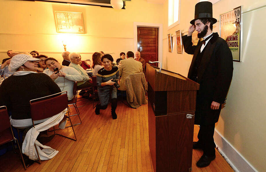 Lincoln impersonator, Peter Daniel Straus, makes an appearance at a Stamford Historical Society fundraising dinner at the society on High Ridge Road Saturday evening.