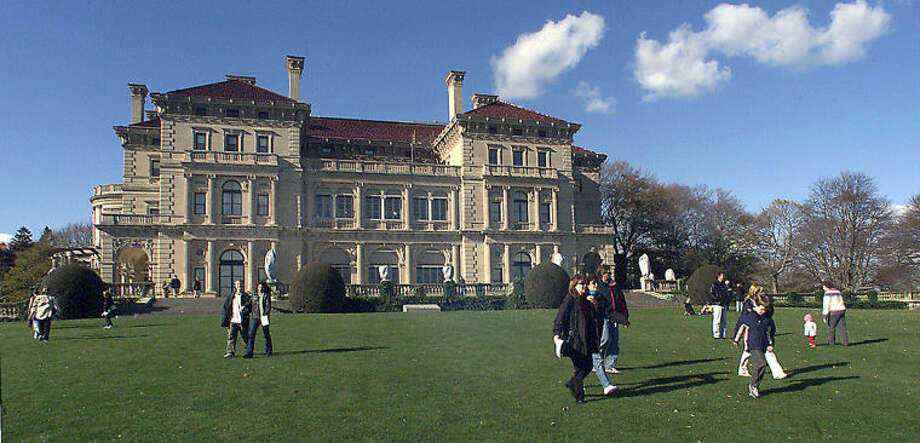 FILE - In this Nov. 12, 2001 file photo, visitors take advantage of free admission to tour The Breakers mansion in Newport, R.I. The Preservation Society of Newport County proposed building a visitor center in 2014 that would sit on the mansion's grounds. The society said it would be unobtrusive and would provide necessary services that currently are lacking at the popular tourist attraction. Some nearby residents are fighting the plan. (AP Photo/Stew Milne, File)