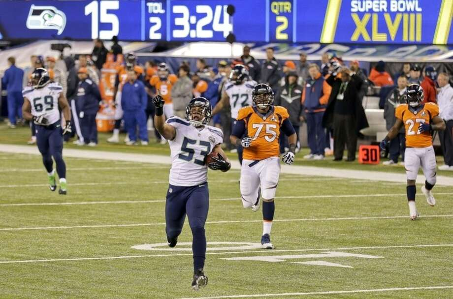 AP Photo/Gregory Bull, FileIn this Feb. 2, 2014, file photo, Seattle Seahawks outside linebacker Malcolm Smith (53) reacts as he returns an interception for a touchdown against the Denver Broncos during the first half of the NFL Super Bowl XLVIII football game in East Rutherford, N.J.