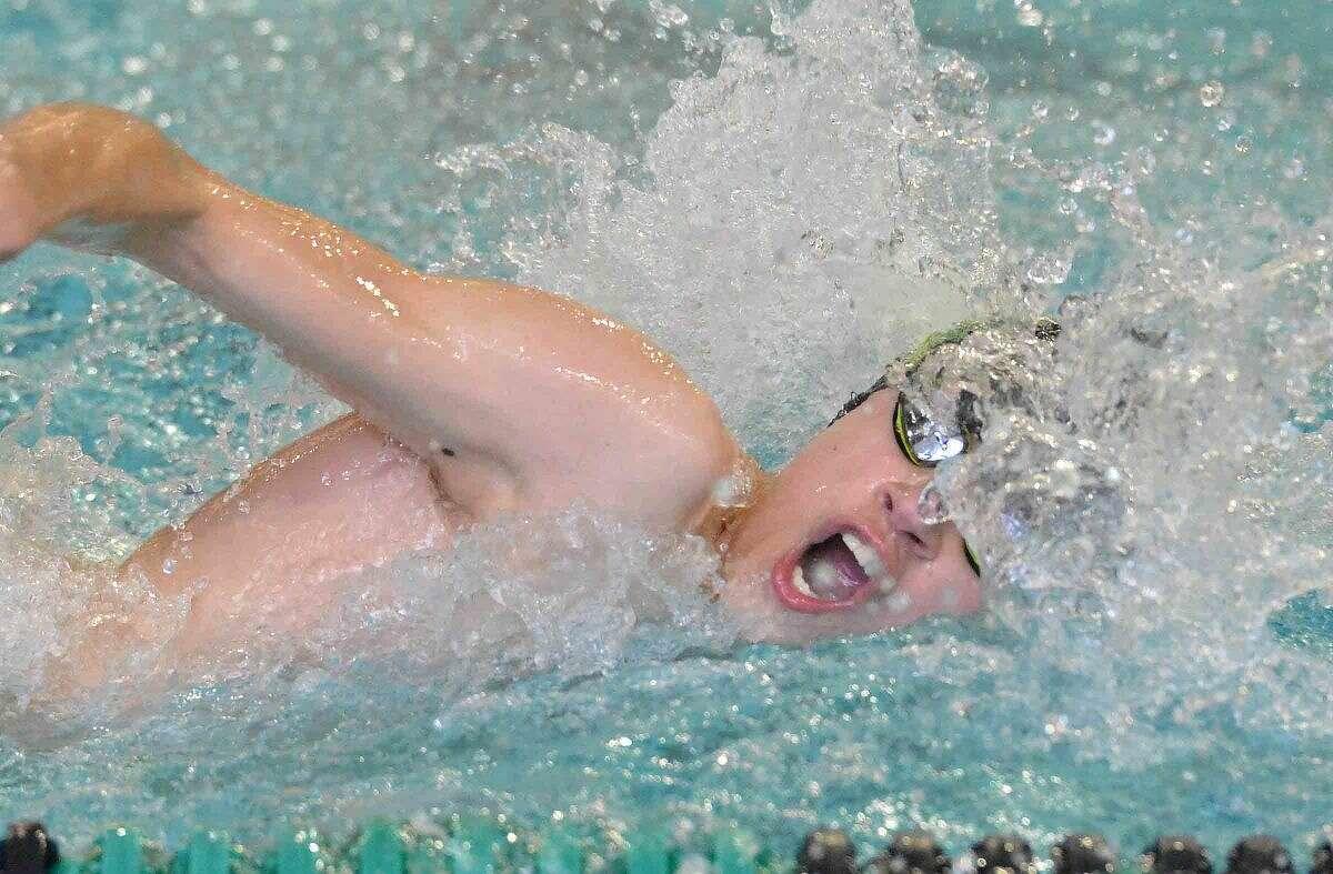 Hour Photo/Alex von Kleydorff Norwalk/McMahons John Kruy swims the 500 free vs Staples