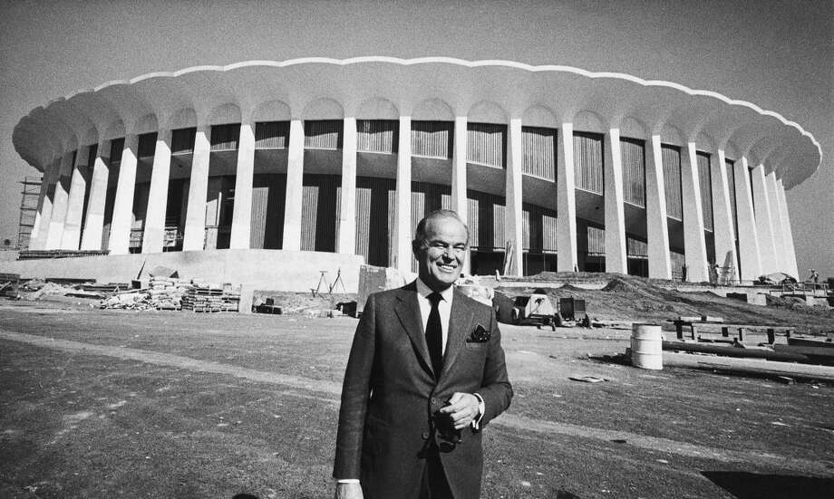 "FILE - In this Nov. 6, 1967, file photo, multi-millionaire Jack Kent Cooke poses outside The Forum in Inglewood, Calif. It is the sports palace he's building as the home base of his Los Angeles Lakers and Los Angeles Kings. The NHL's ""great expansion"" of 1967 gave birth to hockey in California and the Broad Street Bullies and legitimized the league as a major force in North American professional sports. (AP Photo/Harold Filan, File)"