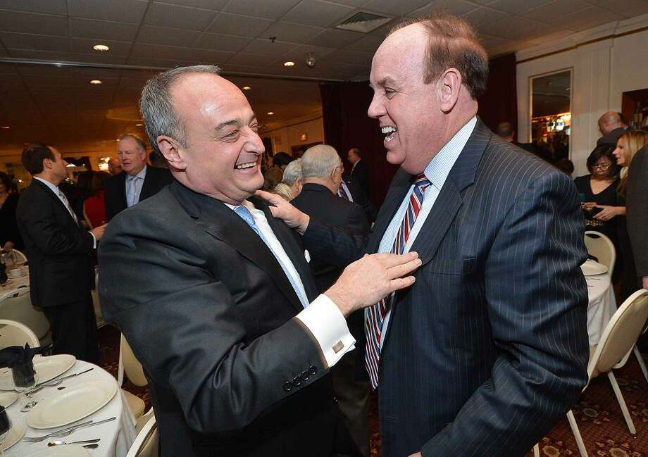 Hour Photo/Alex von Kleydorff Larry Cafero has a laugh as he talks with longtime friend and West Haven State Rep Steve Dargan at a Celebration of a Legislative Career