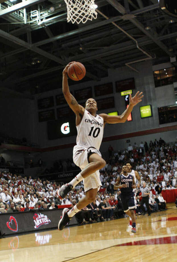 Cincinnati guard Troy Caupain (10) shoots against UConn in the first half of an NCAA college basketball game, Thursday, Jan. 29, 2015, in Cincinnati. (AP Photo/Frank Victores)
