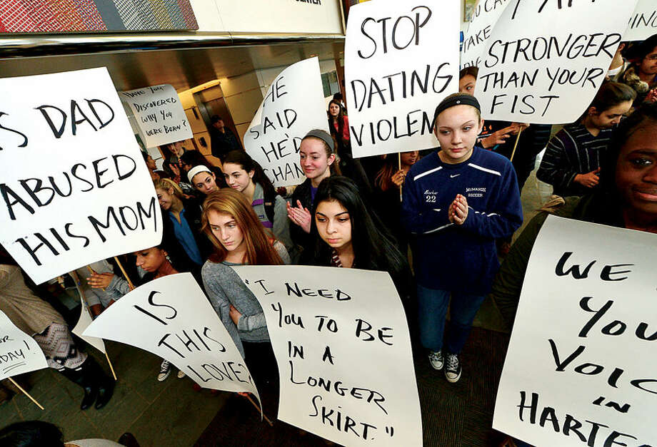 Hour photo / Erik Trautmann Over 50 students from Stamford and Norwalk turned out at a press Conference designating February as Teen Dating Violence Awareness Month at Stamford Government Center Thursday. The program was hosted by Stamford Youth Services Bureau and Center for Youth Leadership at Brien McMahon High. Speakers include students; Stamford mayor David Martin, Norwalk mayor Harry Rilling, State Representative William Tong and Sarah Egan, Connecticut's Child Advocate