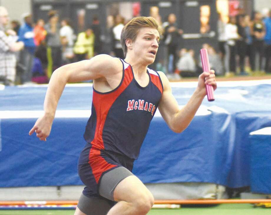 Hour photo/John Nash - Brien McMahon's Niko Petridis sprints the anchor leg of the boys 4x200 relay during Thursday's CIAC Class LL indoor track championship at the Floyd Little Athletic Center in New Haven. The Senators finished second.