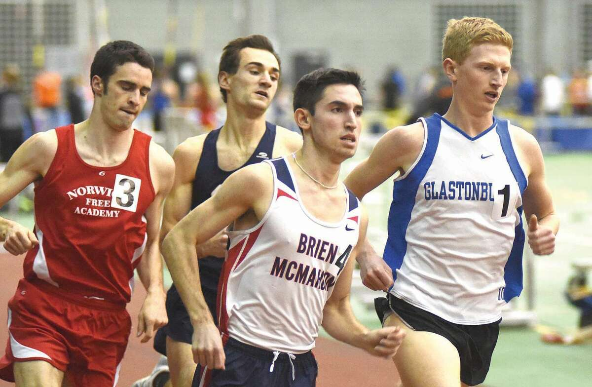 Hour photo/John Nash - Brien McMahon's Eric van der Els, front center, races a pack of runners, including James of Staples, center rear, during the boys 1,000-meter run final in the Class LL indoor track championship meet at Floyd Little Athletic Center in New Haven.