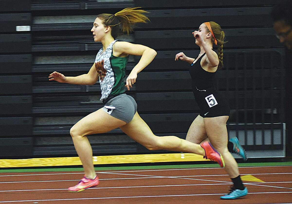 Hour photo/John Nash - Norwalk's Deanna Singewald races to the win in heat race of the 55-meter dash during Thursday's CIAC Class LL track championship meet at the Floyd Little Athletic Center in New Haven.