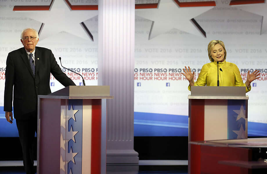 Democratic presidential candidate, Hillary Clinton makes a point as Sen. Bernie Sanders, I-Vt, reatcs during a Democratic presidential primary debate at the University of Wisconsin-Milwaukee, Thursday, Feb. 11, 2016, in Milwaukee. (AP Photo/Morry Gash)