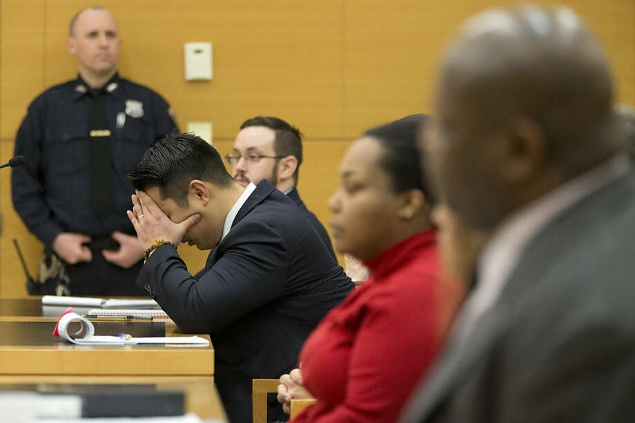Police officer Peter Liang reacts as the verdict is read during his trial on charges in the shooting death of Akai Gurley, Thursday, Feb. 11, 2016 at Brooklyn Supreme court in New York in New York. (AP Photo/Mary Altaffer, Pool)