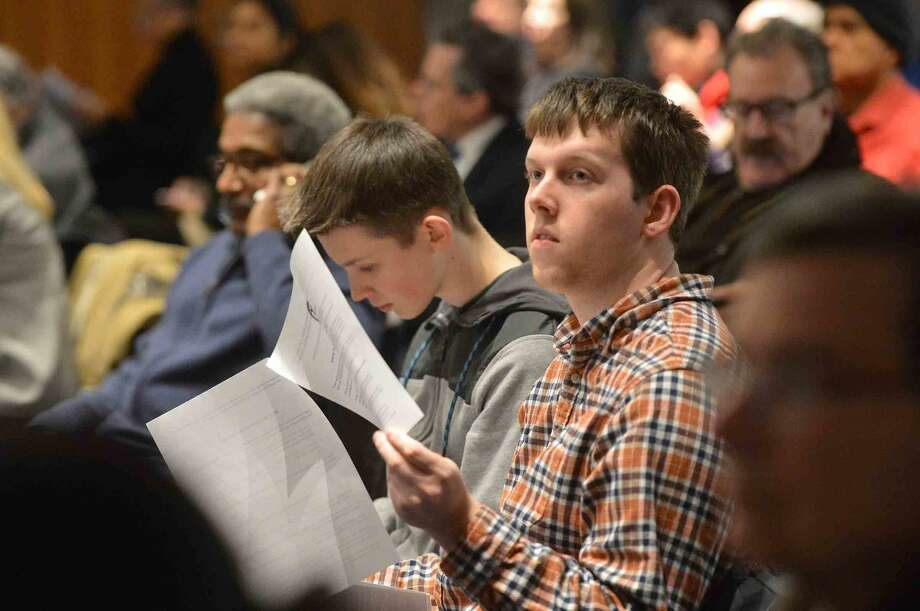 Hour Photo/Alex von Kleydorff Audience members look through some of the issues to be addressed at Governor Malloy's Town Hall Meeting at UCONN