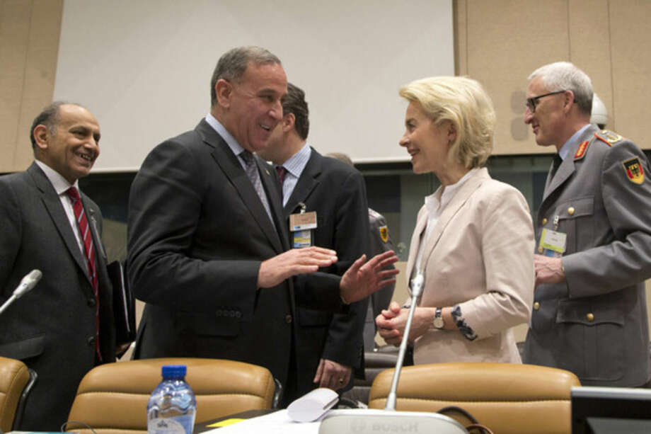 German Defense Minister Ursula von der Leyen, second right, speaks with Iraq's Defense Minister Khaled al-Obeidi, second left, during a Counter-ISIL Coalition Ministerial meeting at NATO headquarters in Brussels on Thursday, Feb. 11, 2016. U.S. Defense Secretary Ash Carter expects Thursday's three-hour gathering of defense ministers from more than two dozen countries to endorse a new U.S. plan for prosecuting the war. The ministers were expected to issue a joint statement at the conclusion of their meeting at NATO headquarters. (AP Photo/Virginia Mayo)