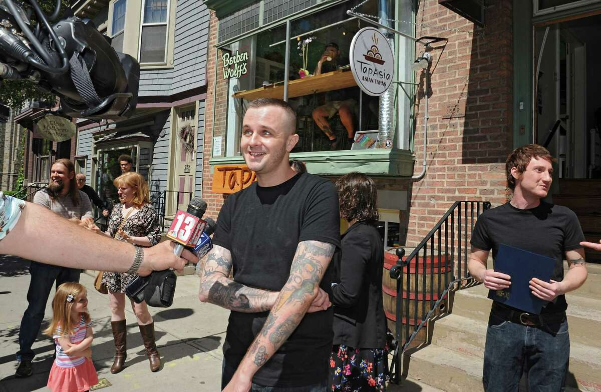 Joey Berben is interviewed by the media at Berben & Wolff's Vegan Delicatessen on their grand opening day at 227 Lark St. Friday, June 10, 2016 in Albany, N.Y. Co-founder Max Wolff is seen at right. (Lori Van Buren/Times Union)