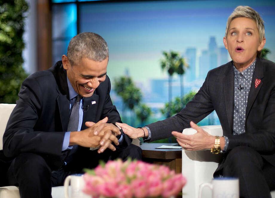 President Barack Obama laughs with Ellen DeGeneres during a commercial break while taping a show segment of the Ellen DeGeneres Show in Burbank, Calif., Thursday, Feb. 11, 2016. (AP Photo/Pablo Martinez Monsivais)