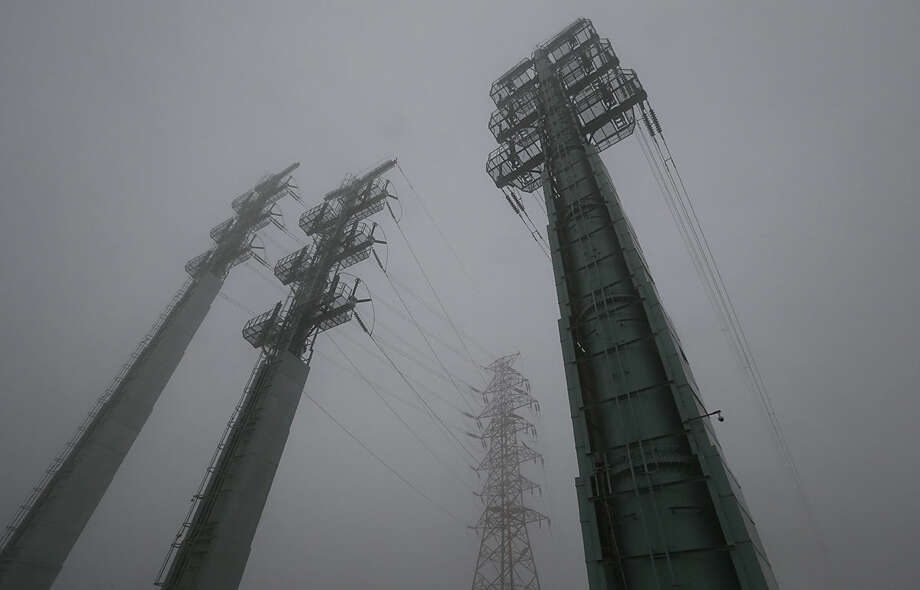 Transmission towers supplying power to the Kaesong Industrial Complex from South Korea are seen on a foggy and rainy day after South Korea cut off power, in Paju, South Korea, Friday, Feb. 12, 2016. South Korea has cut off power and water supplies to a factory park in North Korea, officials said Friday, a day after the North deported all South Korean workers there and ordered a military takeover of the complex that had been the last major symbol of cooperation between the rivals. (AP Photo/Lee Jin-man)