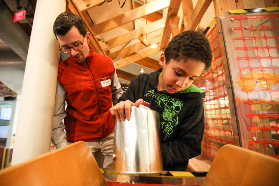 Hour photo/Chris Palermo Jordy Garcia, 8 plays with his mentor Andy Tibbetts at the Norwalk Mentor Program's annual mentor/mentee event at Stepping Stones Museum Thursday night.