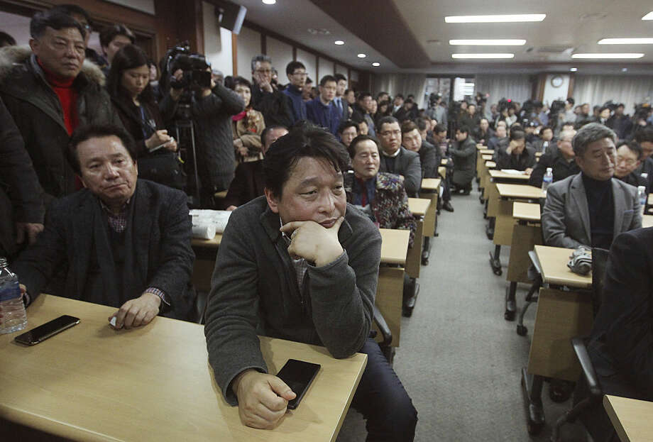 """South Korean owners who run factories in the suspended inter-Korean Kaesong Industrial Complex, attend an emergency meeting held by the council of South Korean companies operating in the industrial park, in Seoul, South Korea, Friday, Feb. 12, 2016. North Korea on Thursday ordered a military takeover of a factory park that had been the last major symbol of cooperation with South Korea, calling Seoul's earlier suspension of operations at the jointly run facility as punishment for the North's recent rocket launch a """"dangerous declaration of war.""""(AP Photo/Ahnn Young-joon)"""