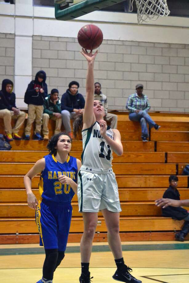Norwalk's Brianna FItzgerald goes up for a layup. Fitzgerald scored four points in the Bears' 68-32 in over Harding. (Pete Paguaga/Hour photo)