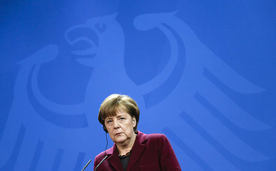 German Chancellor Angela Merkel attends a joint press conference with Iraqi Prime Minister Haider al-Abadi at the chancellery in Berlin, Thursday, Feb. 11, 2016. (AP Photo/Markus Schreiber)
