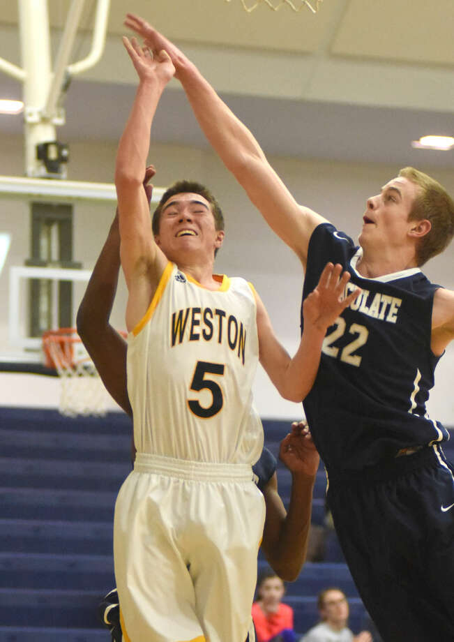 Hour photo/John Nash - Weston hosted Immaculate in an SWC boys basketball game on Friday, Jan. 30, 2015.