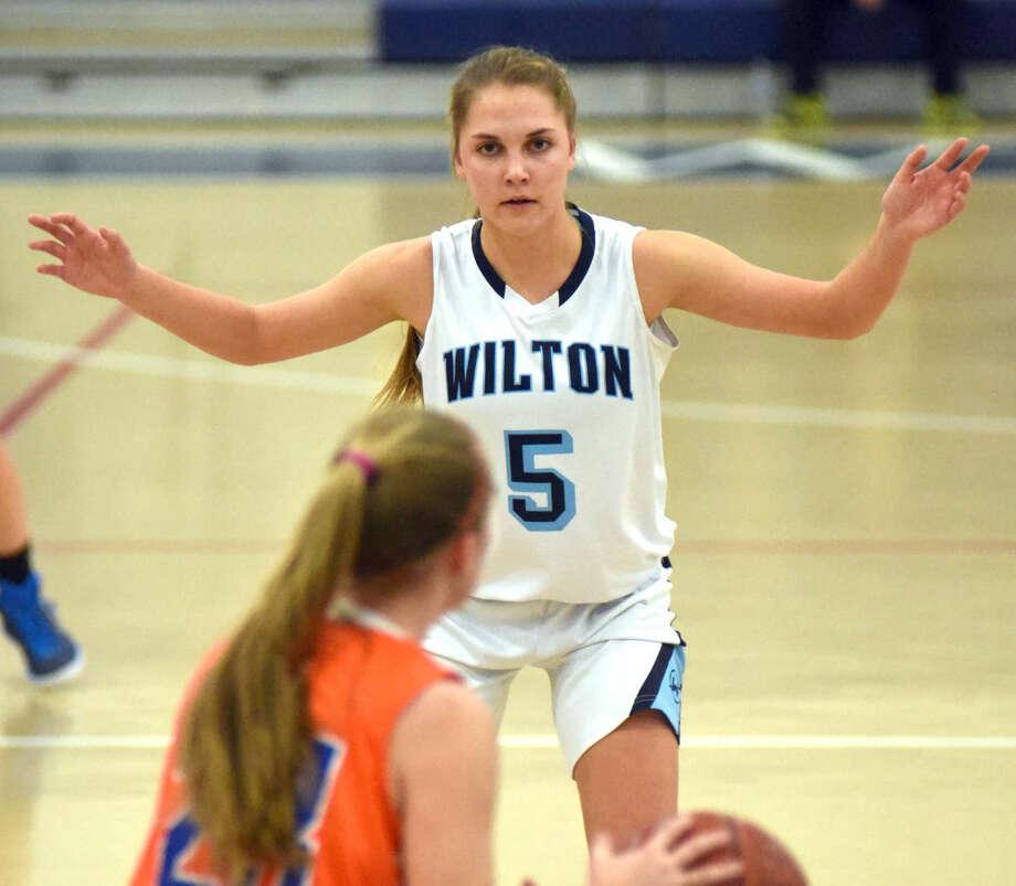 Hour photo/John Nash - The Wilton girls basketball team won its 13th straight game on Thursday night, crusing past three-time defending FCIAC champion Danbury by a 67-25 score.