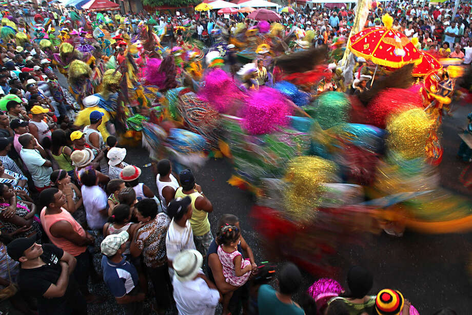 In this Feb. 8, 2016 photo, people watch Maracatu dancers perform for Carnival in Nazare da Mata, Brazil. This city in northern Brazil is considered the cradle of the maracatu, a frenetic, rhythmic dance of African origin that infuses its unique Carnival celebration with its spirit. (AP Photo/Eraldo Peres)