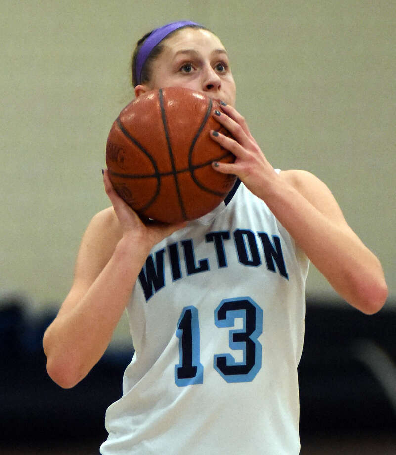 Hour photo/John Nash - The Wilton girls basketball team won its 13th straight game on Thursday night, crusing past three-time defending FCIAC champion Danbury by a 67-25 score.
