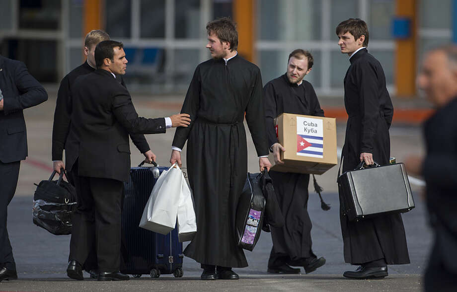 Members of the Russian Orthodox church arrive to the Jose Marti International Airport in Havana, Cuba, Thursday, Feb. 11, 2016. Pope Francis and the leader of the Russian Orthodox Church will meet in Cuba Friday in a historic step to heal the almost 1,000-year-old schism that divided Christianity between East and West. (AP Photo/Desmond Boylan)