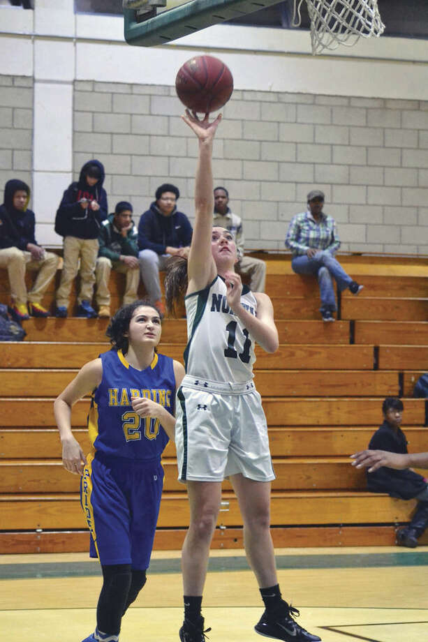Hour photo/Pete PaguagaNorwalk's Brianna FItzgerald goes up for a layup. Fitzgerald scored four points in the Bears' 68-32 in over Harding.