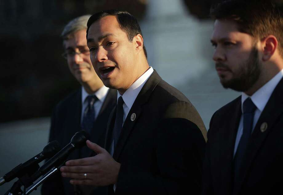 U.S. Rep. Joaquin Castro (D-TX) (2nd L) speaks as Rep. Ruben Gallego (D-AZ) (R) and Mexican American Legal Defense and Education Fund President and General Counsel Thomas Saenz (L) listen during a news conference in front of the Supreme Court December 8, 2015 in Washington, DC. Castro and his allies are taking their fight to the Congressional House floor to remove the term illegal aliens from official records archived by the Library of Congress. Republicans are pushing back, setting up a fight that will become part of the presidential campaign.  (Photo by Alex Wong/Getty Images) Photo: Alex Wong, Staff / Getty Images / 2015 Getty Images
