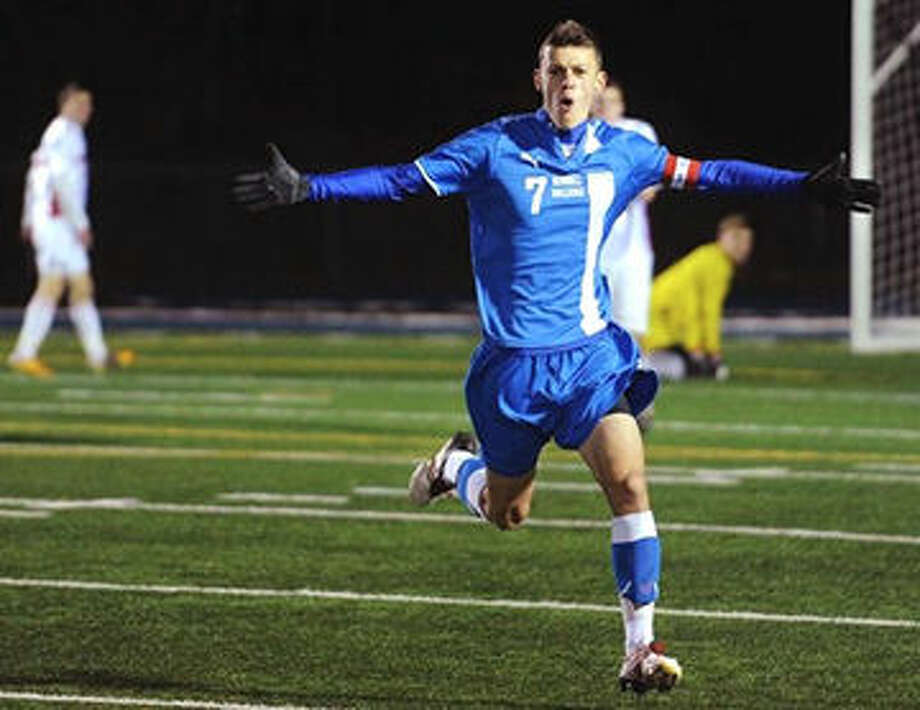 Justin Lewis celebrates on his high school soccer field in Stratford.