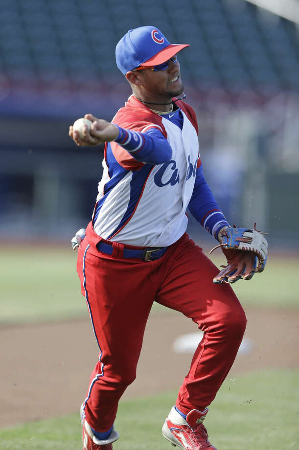 FILE - In this July 19, 2013 file photo, Cuba third baseman Yulieski Gourriel warms up prior to an exhibition baseball game against the United States in Papillion, Neb. A baseball official in the Dominican Republic said on Monday, Feb. 8, 2016, that Gourriel has abandoned his team at the close of the annual Caribbean series. The 31-year-old was with his younger brother, Lourdes, also a highly sought player. (AP Photo/Nati Harnik, File)