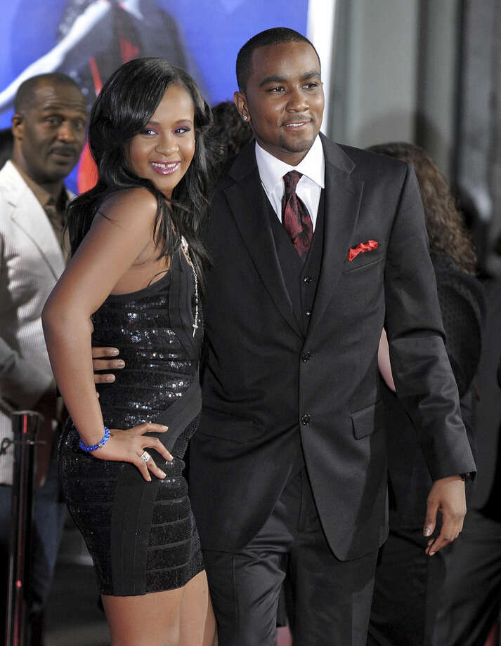 "FILE - In this Aug. 16, 2012, file photo, Bobbi Kristina Brown, left, and Nick Gordon attend the Los Angeles premiere of ""Sparkle"" at Grauman's Chinese Theatre in Los Angeles. Brown is moving to hospice care after months of receiving medical care. Pat Houston says in a statement Wednesday, June 24, 2015, that Whitney Houston's daughter's ""condition has continued to deteriorate. She was found face-down and unresponsive in a bathtub of her Georgia home on Jan. 31. (Photo by Jordan Strauss/Invision/AP, File)"