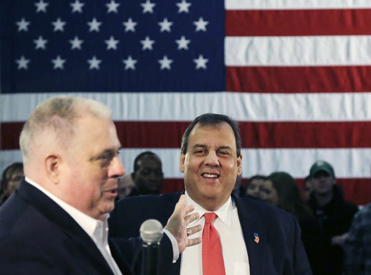 Republican presidential candidate, New Jersey Gov. Chris Christie smiles as he is introduced by Maryland Gov. Larry Hogan at a town hall-style campaign event, Monday, Feb. 8, 2016, in Hudson, N.H. (AP Photo/Elise Amendola)