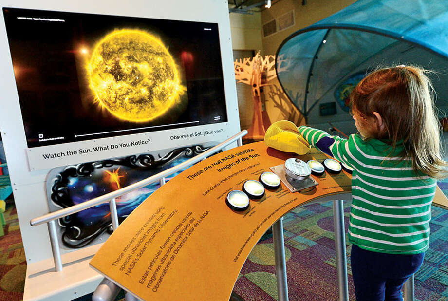 Hour photo / Erik Trautmann 2 year old Sable Shurman watches what the so does as partt of the amazing planetarium-like exhibit, My Sky, Saturday at the Stepping Stones Museum for Children. My Sky, which is open through Memorial Day, was created by Boston Children's Museum and Smithsonian Astrophysical Observatory and is based upon work supported by NASA.