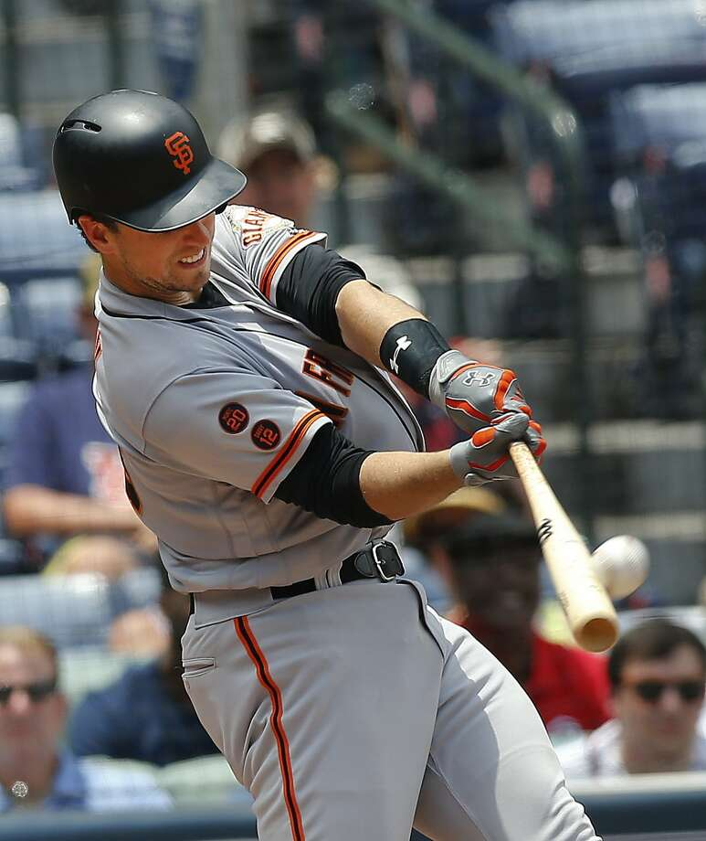 Buster Posey had a cortisone shot in his left thumb in St. Louis. He returns to the lineup Friday night. Photo: John Bazemore, Associated Press
