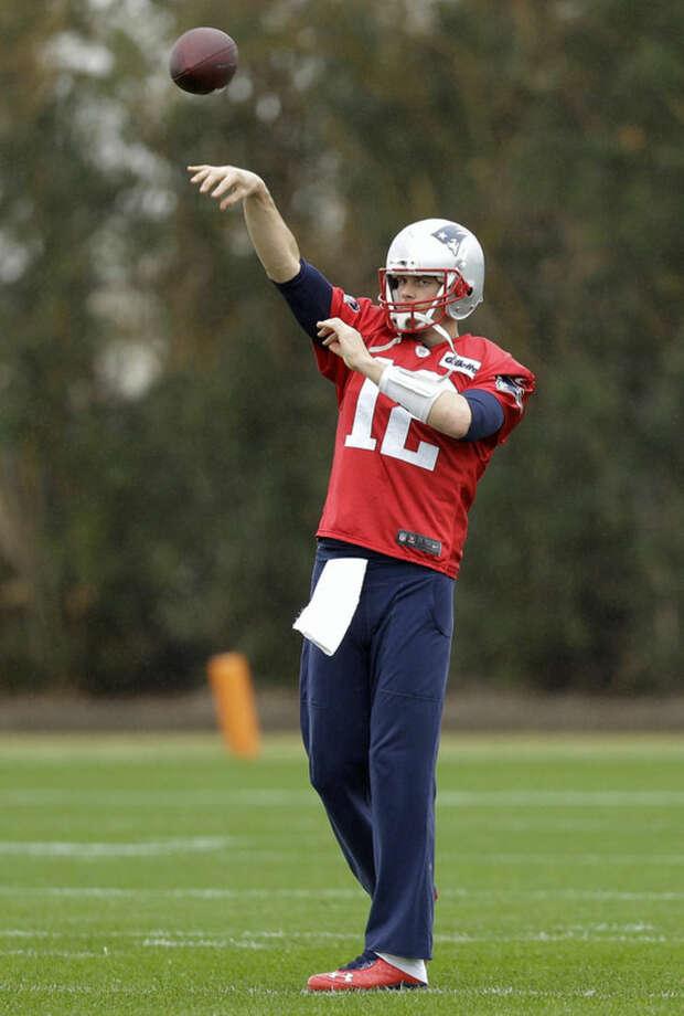 New England Patriots quarterback Tom Brady passes during practice Friday, Jan. 30, 2015, in Tempe, Ariz. The Patriots play the Seattle Seahawks in NFL football Super Bowl XLIX Sunday, Feb. 1. (AP Photo/Mark Humphrey)