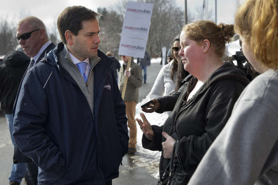 "Republican presidential candidate, Sen. Marco Rubio, R-Fla., speaks with Stephanie Tespas, of Derry, N.H., outside of Gilbert Hood Middle School in Derry, Tuesday, Feb. 9, 2016, during the New Hampshire primary. Tespas spoke with Rubio about her son's genetic condition, the same as her husband who battled and survived cancer. Tespas left the school gymnasium without saying who she supported, except that it wasn't Rubio.""I just don't think he's quite ready,"" she said. ""I wanted him to be more personal. I felt like I was in one of his commercials."" (AP Photo/Jacquelyn Martin)"