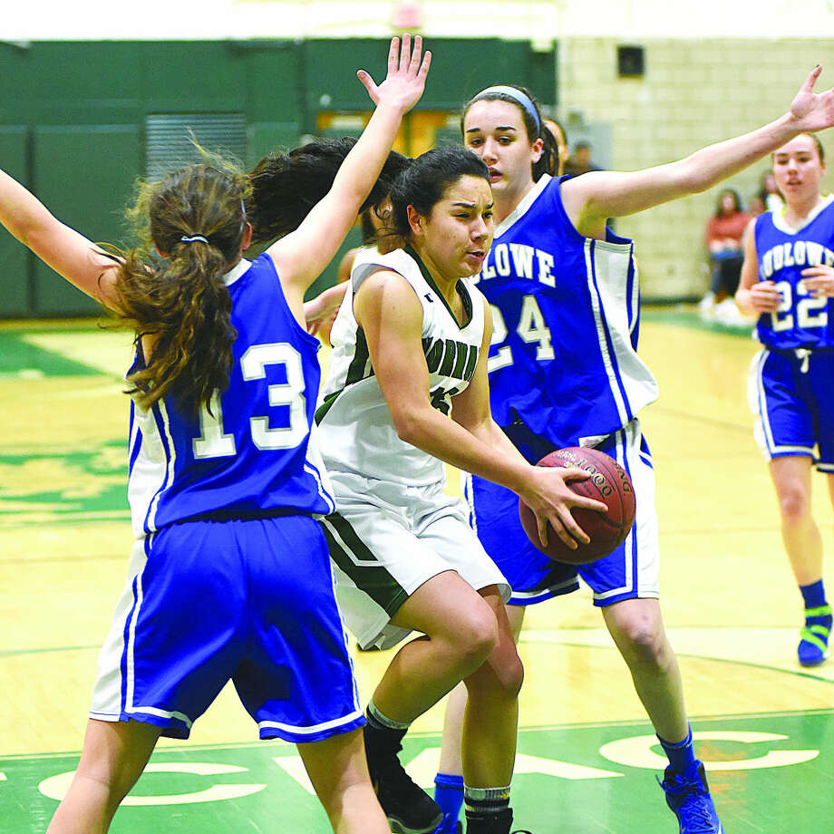 Hour photo/John Nash - Norwalk's Tatiana Arias, center, cuts between Fairfield Ludlowe's Bridget O'Leary (13) and Alex McKinnon (right) during the first half of Tuesday night's game at Scarso Gym in Norwalk.