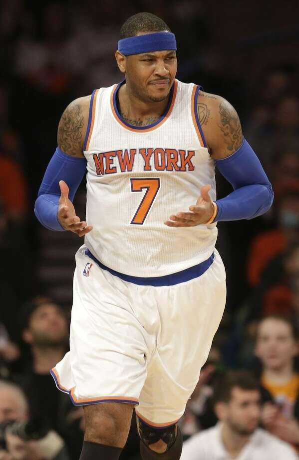New York Knicks' Carmelo Anthony reacts during the first half of the NBA basketball game against the Los Angeles Lakers, Sunday, Feb. 1, 2015 in New York. (AP Photo/Seth Wenig)